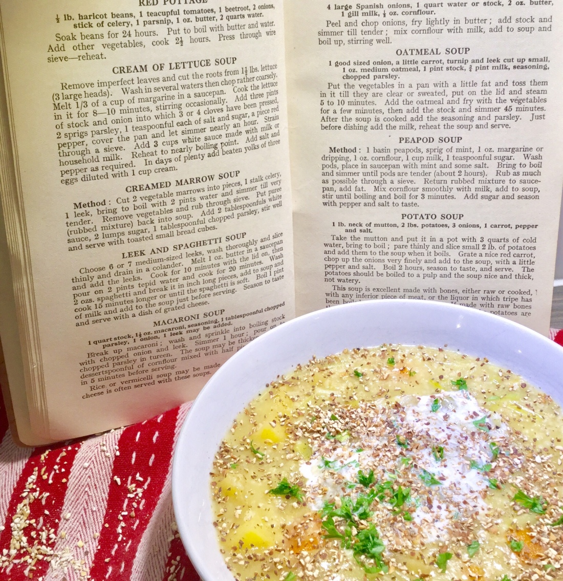 A bowl of oatmeal soup and a recipe book