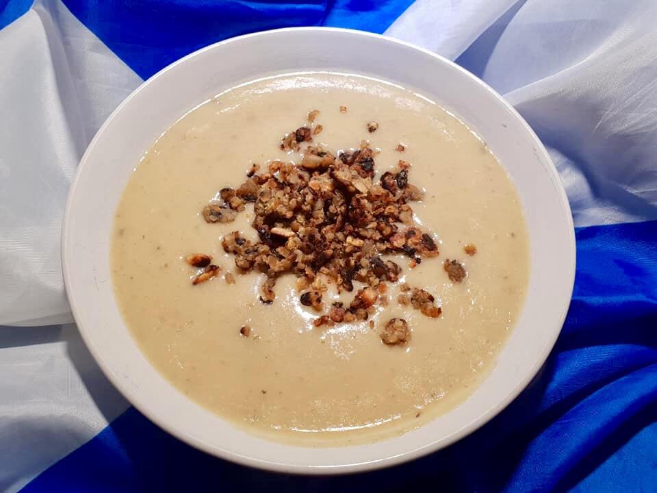 A bowl of veggie haggis soup